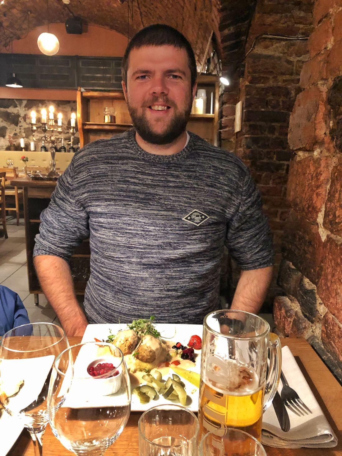 Dan eating Swedish meatballs Stockholm