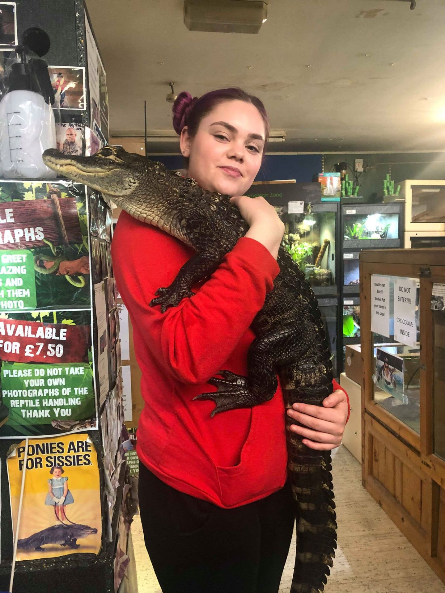 girl holding a reptile