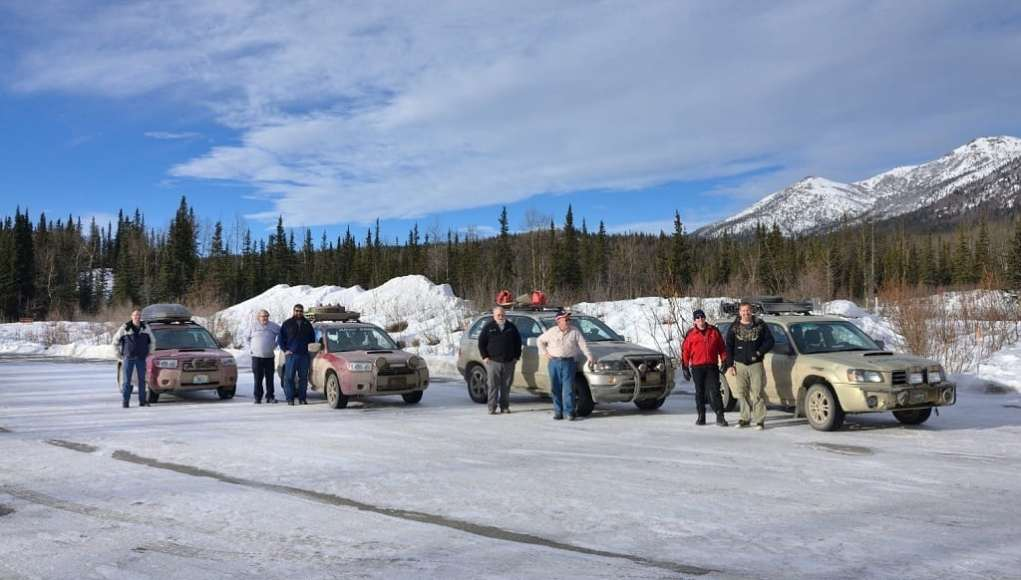 Teams posing at Denali National Park, but as usual, you can't actually see the mountain hiding in the clouds.