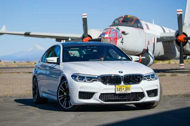 2019 BMW M5 near an airplane during Run to the Sun.