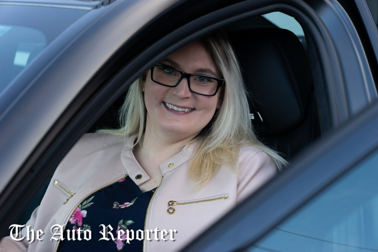 Sitting in a BMW M5 at the Beauty & Key's launch at The Shop - The Auto Reporter