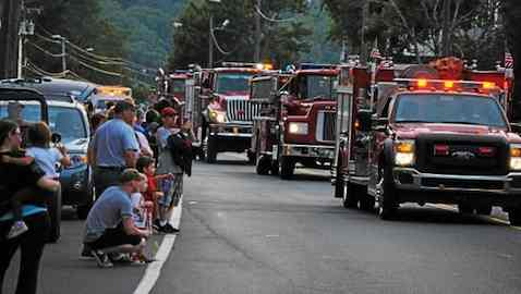 Dozens of fire departments from around Connecticut walked and drove the length of Winsted's Main Street. (Jessica Glenza-Register Citizen)