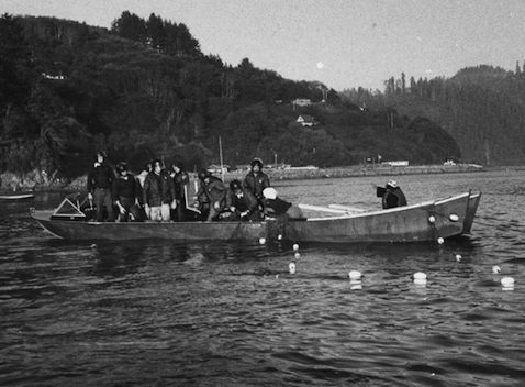 A Coast Guard boat intercepting two Native Americans trying to get to Alcatraz. Photo Courtesy El Tecolote Archives, 1969