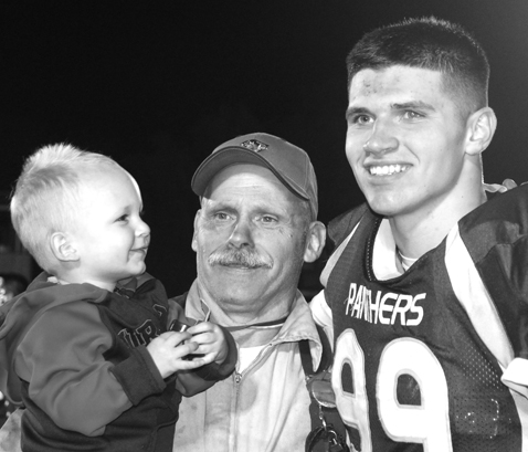 Kuny with grandson and one of his standout players in 2015's championship season