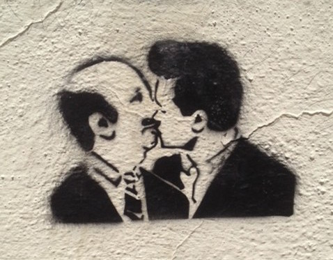 Mexican graffiti from Guanajuato showing current Mexican President Nieto kissing former President Carlos Salinas.