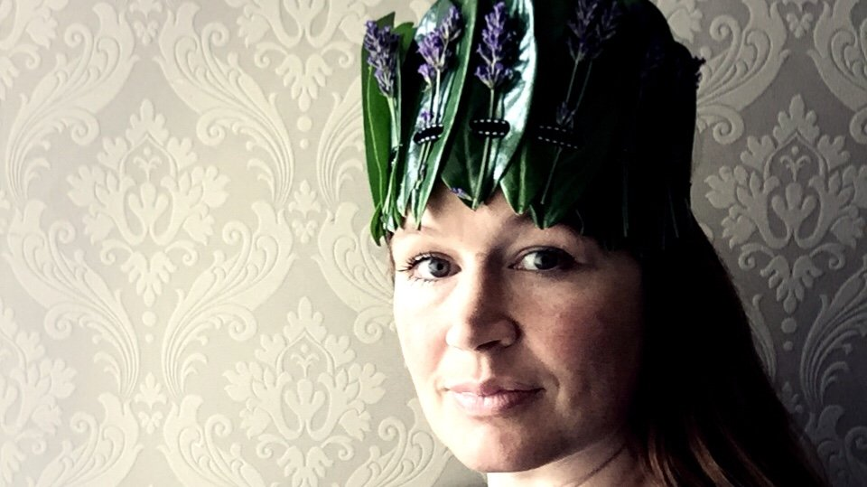 Ulla Lake wearing a sustainable laurel crown with lavender sprigs
