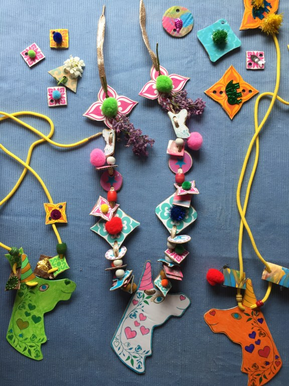 make recycled cardboard nature necklaces in rainbow colours with kids free unicorn craft printable