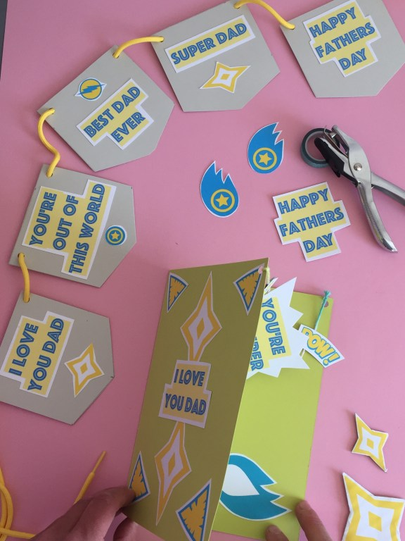 the finished superhero themed kids homemade fathers day card and bunting - made with our free pdf craft printables