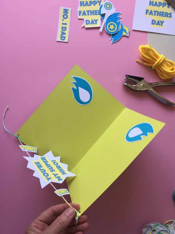 tie the string to your kids craft homemade fathers day card to create the pop up effect