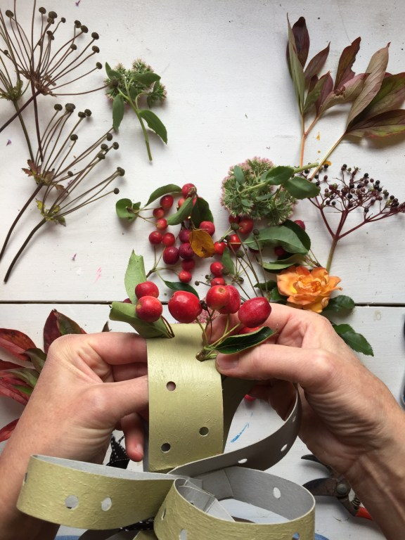 insert your gathered foliage into the holes in your card fascinator