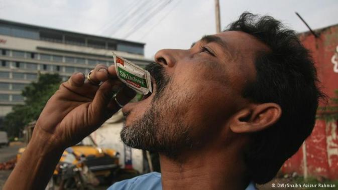 Man eating Tobacco