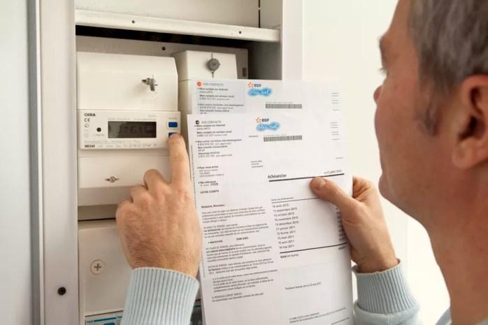 Man checking his electric bill.
