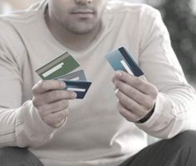 Man Choosing Between Multiple Credit Cards
