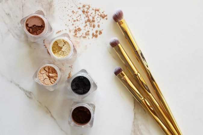 High Angle View Of Beauty Products On White Table
