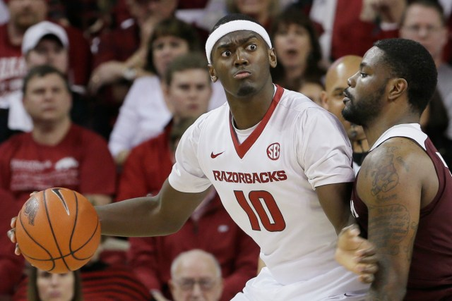 Arkansas's Bobby Portis (10) works the ball around Texas A&M's Kourtney Roberson in the first half of an NCAA college basketball game in Fayetteville, Ark., Tuesday, Feb. 24, 2015. (AP Photo/Danny Johnston)