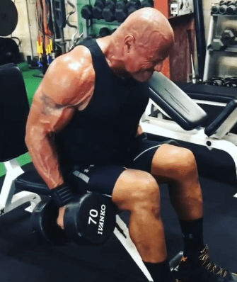 The Rock seated leaning dumbbell shrug