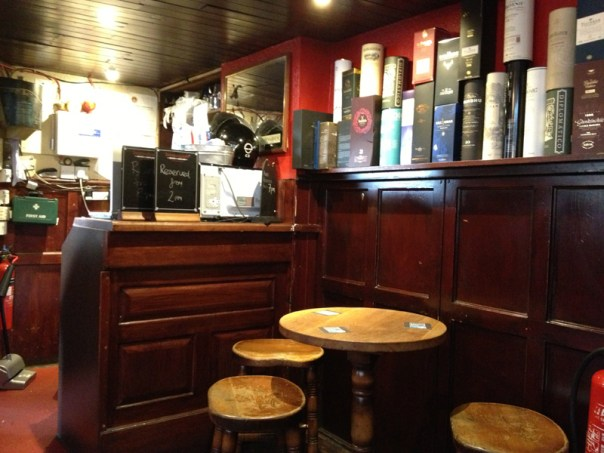 The back corner of the pub where the nuts and bolts of the establishment are not exactly hidden from view