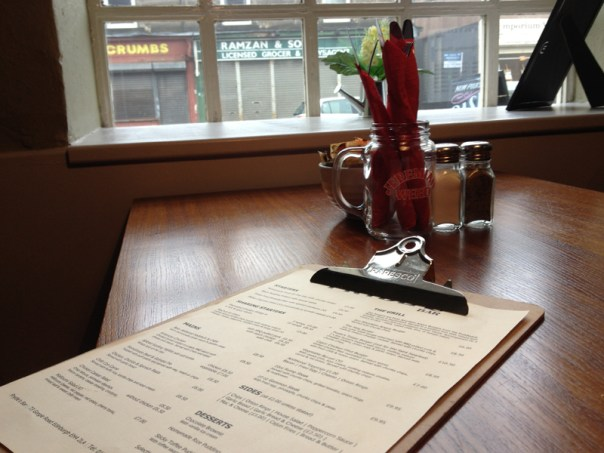 The menu and one of the window booths at Pryde's in Gorgie