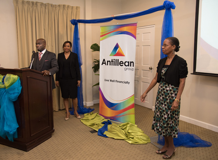 Executive Chairman of NEWIM Holdings Limited, Kennie John (front), Mrs. Lisa Thomas-John, HR Manager/Corperate Affairs Manager and Mrs. Roslyn John, Company Secretary (right) as they unveil the new brand that signals the introduction of Antillean Group, at the Spice Island Beach Resort.