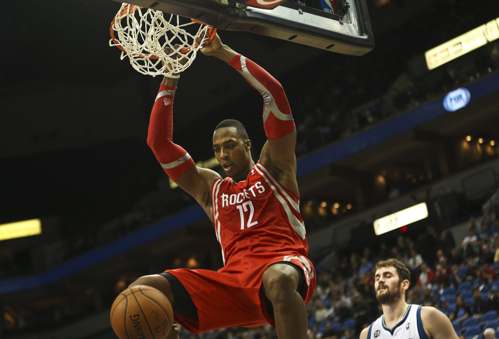 Feb. 10, 2014 - Minneapolis, MN, USA - Houston Rockets' Dwight Howard dunks the ball against Minnesota Timberwolves' Kevin Love during the second half at the Target Center in Minneapolis, Minn., on Monday, Feb. 10, 2014 (Renee Jones Schneider/Zuma Press/Icon Sportswire)