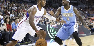 Oct 18, 2014 - Las Vegas, Nevada, U.S. - Los Angeles Clippers guard Chris Paul (3) drives past Denver Nuggets' Ty Lawson (3) during the first half of a preseason NBA basketball game at Mandalay Bay Resort Event Center in Las Vegas. (Bizuayehu Tesfaye/Zuma Press/Icon Sportswire)