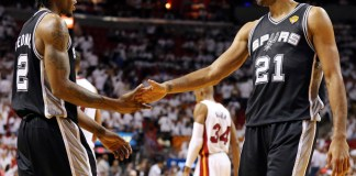 June 10, 2014 - Miami, FLORIDA, USA: San Antonio Spurs forward Kawhi Leonard (2) and Tim Duncan (21) react after a play during Game 3 of the NBA Finals against the Miami Heat at American Airlines Arena. (San Antonio Express-News/Zumapress/Icon Sportswire)
