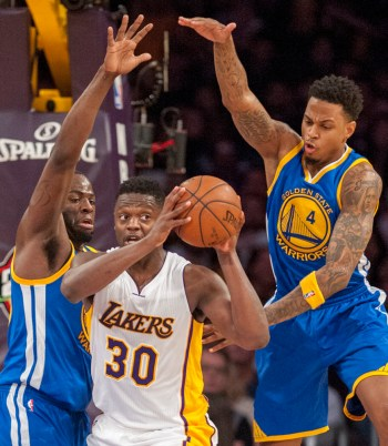 March 6, 2016 - Los Angeles - Lakers forward Julius Randle looks to get rid of the ball after being surrounded by the Warriors forward Draymond Green and forward Brandon Rush during the second half at Staples Center in Los Angeles, California on March 6, 2016. Lakers beat the Golden 112 to 95 (Michael Goulding/Zuma Press/Icon Sportswire)