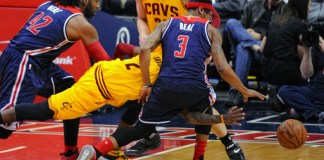 28 February 2016: Cleveland Cavaliers guard Kyrie Irving (2) fouls Washington Wizards guard Bradley Beal (3) going for a loose ball at the Verizon Center in Washington, D.C. where the Washington Wizards defeated the Cleveland Cavaliers, 113-99. (Icon Sportswire)