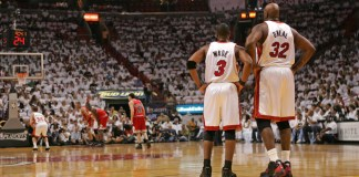 Apr 27, 2007; Miami, FL, USA; Miami Heat guard Dwyane Wade (3) and center Shaquille O'Neal (32) converse as Jason Williams shoots a free throw in the first quarter. Mandatory Credit-Palm Beach Post/TSN/Icon Sportswire