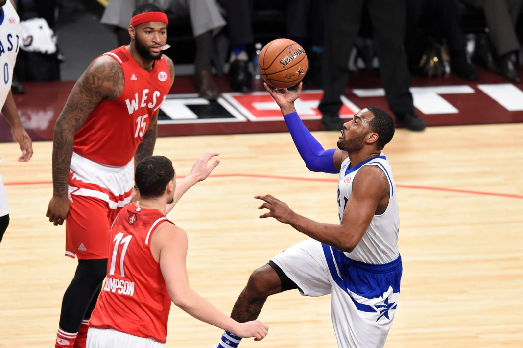 Feb 14, 2016; Toronto, Ontario, CAN; Eastern Conference guard John Wall of the Washington Wizards (2) prepares to shoot the ball in front of Western Conference guard Klay Thompson of the Golden State Warriors (11) and Western Conference center DeMarcus Cousins of the Sacramento Kings (15) in the second quarter during the NBA All Star Game at Air Canada Centre. Mandatory Credit: Peter Llewellyn-USA TODAY Sports