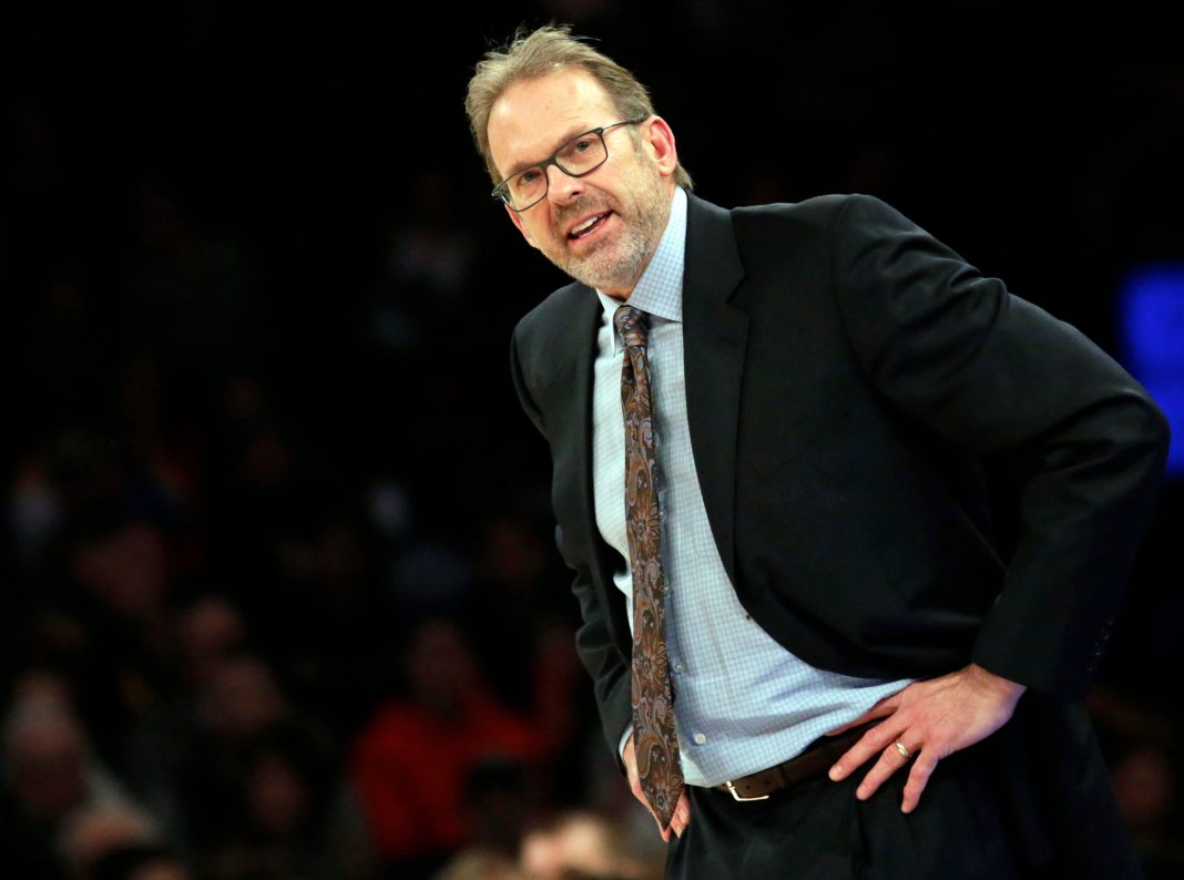 Apr 10, 2016; New York, NY, USA; New York Knicks interim head coach Kurt Rambis reacts against the Toronto Raptors during the second half at Madison Square Garden. The Raptors defeated the Knicks 93-89. Mandatory Credit: Adam Hunger-USA TODAY Sports