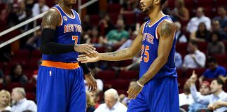 Oct 4, 2016; Houston, TX, USA; New York Knicks guard Derrick Rose (25) celebrates with forward Carmelo Anthony (7) after a play during the third quarter against the Houston Rockets at Toyota Center. The Rockets won 130-103. Mandatory Credit: Troy Taormina-USA TODAY Sports