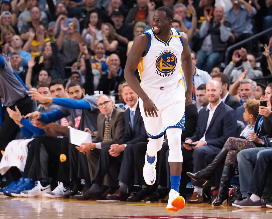 Nov 9, 2016; Oakland, CA, USA; Golden State Warriors forward Draymond Green (23) reacts ahead of the bench after a basket against the Dallas Mavericks during the second quarter at Oracle Arena. Mandatory Credit: Kelley L Cox-USA TODAY Sports