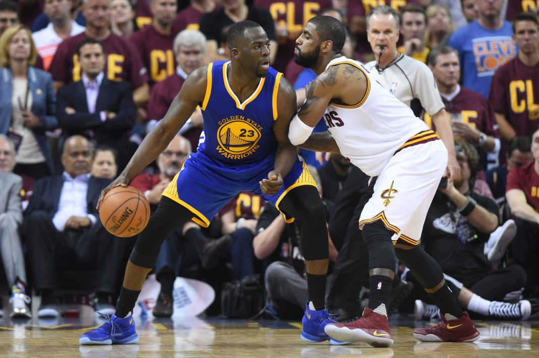 Jun 10, 2016; Cleveland, OH, USA; Golden State Warriors forward Draymond Green (23) dribbles the ball as Cleveland Cavaliers guard Kyrie Irving (2) defends during the third quarter in game four of the NBA Finals at Quicken Loans Arena. Mandatory Credit: Ken Blaze-USA TODAY Sports