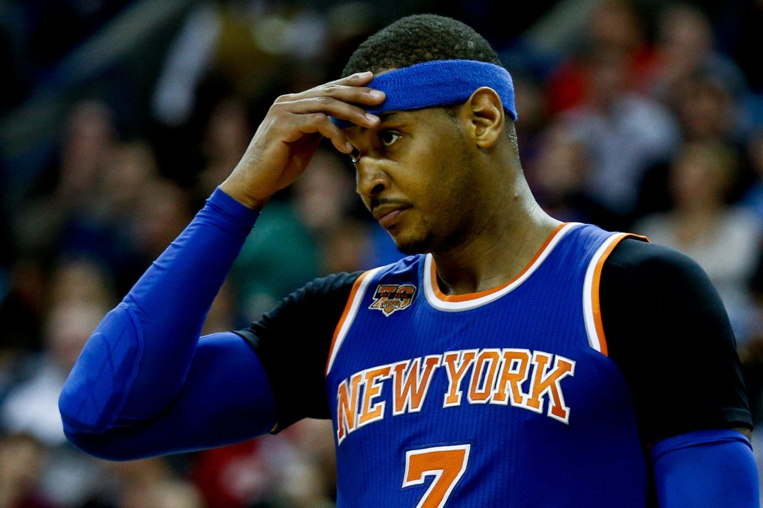 Dec 30, 2016; New Orleans, LA, USA; New York Knicks forward Carmelo Anthony (7) reacts to a call during the second half of a game against the New Orleans Pelicans at the Smoothie King Center. The Pelicans defeated the Knicks 104-92. Mandatory Credit: Derick E. Hingle-USA TODAY Sports