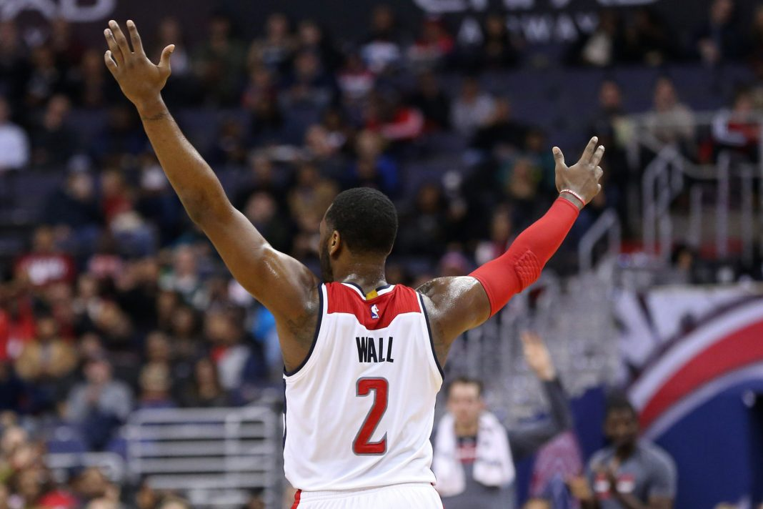 Jan 6, 2017; Washington, DC, USA; Washington Wizards guard John Wall (2) gestures on the court against the Minnesota Timberwolves in the second quarter at Verizon Center. Mandatory Credit: Geoff Burke-USA TODAY Sports