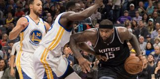 January 8, 2017; Sacramento, CA, USA; Sacramento Kings forward DeMarcus Cousins (15) dribbles the basketball against Golden State Warriors guard Stephen Curry (30) and forward Draymond Green (23, center) during the third quarter at Golden 1 Center. The Warriors defeated the Kings 117-106. Mandatory Credit: Kyle Terada-USA TODAY Sports