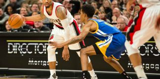 Jan 29, 2017; Portland, OR, USA; Portland Trail Blazers guard Damian Lillard (0) sets up a play as he is guarded by Golden State Warriors guard Patrick McCaw (0) during the second half at the Moda Center. The Warriors won 113-111. Mandatory Credit: Troy Wayrynen-USA TODAY Sports