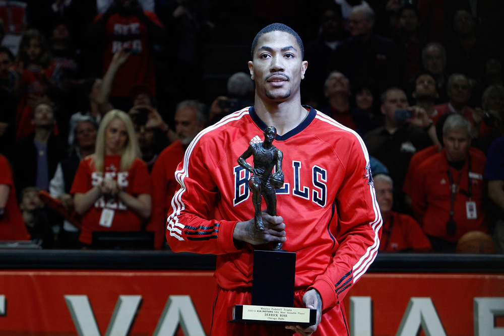 May 4, 2011; Chicago, IL, USA; Chicago Bulls point guard Derrick Rose (1) with the MVP trophy prior to the Chicago Bulls 86-73 victory over the Atlanta Hawks at the United Center. Mandatory credot-Icon Sportswire