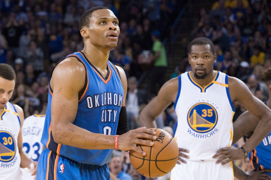November 3, 2016; Oakland, CA, USA; Oklahoma City Thunder guard Russell Westbrook (0) shoots a technical foul shot as Golden State Warriors forward Kevin Durant (35) looks on during the second quarter at Oracle Arena. Mandatory Credit: Kyle Terada-USA TODAY Sports