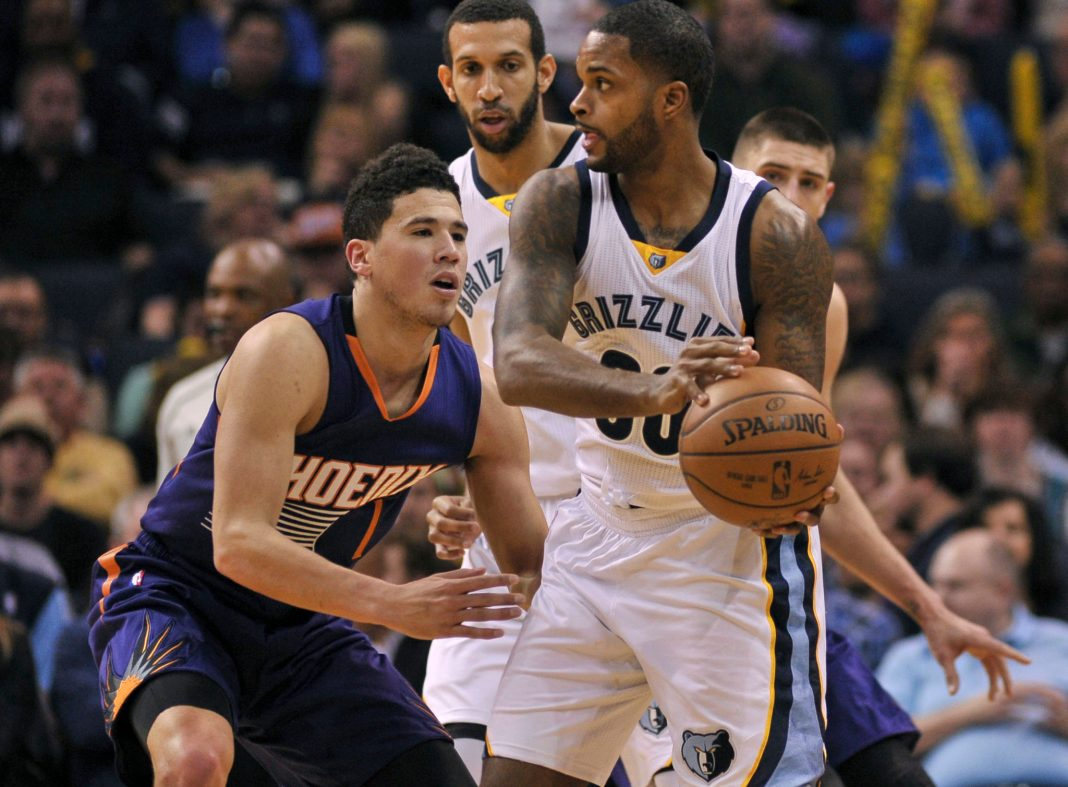 Feb 8, 2017; Memphis, TN, USA; Memphis Grizzlies guard Troy Daniels (30) handles the ball against Phoenix Suns guard Devin Booker (1) during the first half at FedExForum. Mandatory Credit: Justin Ford-USA TODAY Sports