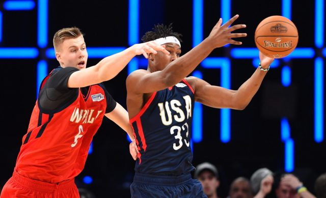 Feb 17, 2017; New Orleans, LA, USA; U.S. Team center Myles Turner of the Indiana Pacers (33) and World Team forward Kristaps Porzingis of the New York Knicks (6) go for a loose ball during the Rising Stars Challenge at Smoothie King Center. Mandatory Credit: Bob Donnan-USA TODAY Sports
