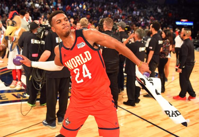 Feb 17, 2017; New Orleans, LA, USA; World Team guard Buddy Hield of the New Orleans Pelicans (25) throws mini basketballs into the crowd after the Rising Stars Challenge at Smoothie King Center. Mandatory Credit: Bob Donnan-USA TODAY Sports