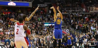Feb 28, 2017; Washington, DC, USA; Golden State Warriors guard Stephen Curry (30) misses the game-winning basket over Washington Wizards forward Kelly Oubre Jr. (12) in the final seconds in the fourth quarter at Verizon Center. The Wizards won 112-108. Mandatory Credit: Geoff Burke-USA TODAY Sports