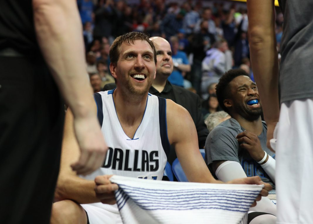 Mar 5, 2017; Dallas, TX, USA; Dallas Mavericks forward Dirk Nowitzki (41) reacts on the bench after missing three three point attempts in the second half against the Oklahoma City Thunder at American Airlines Center. The Mavs beat the Thunder 104-89. Mandatory Credit: Matthew Emmons-USA TODAY Sports