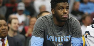 Mar 6, 2017; Denver, CO, USA; Denver Nuggets guard Emmanuel Mudiay (0) watches from the bench during the first half against the Sacramento Kings at Pepsi Center. Mandatory Credit: Chris Humphreys-USA TODAY Sports