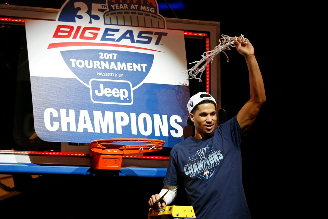Mar 11, 2017; New York, NY, USA; Villanova Wildcats guard Josh Hart (3) reacts while cutting down the net after defeating the Creighton Bluejays in the Big East Conference Tournament final game at Madison Square Garden. Mandatory Credit: Adam Hunger-USA TODAY Sports