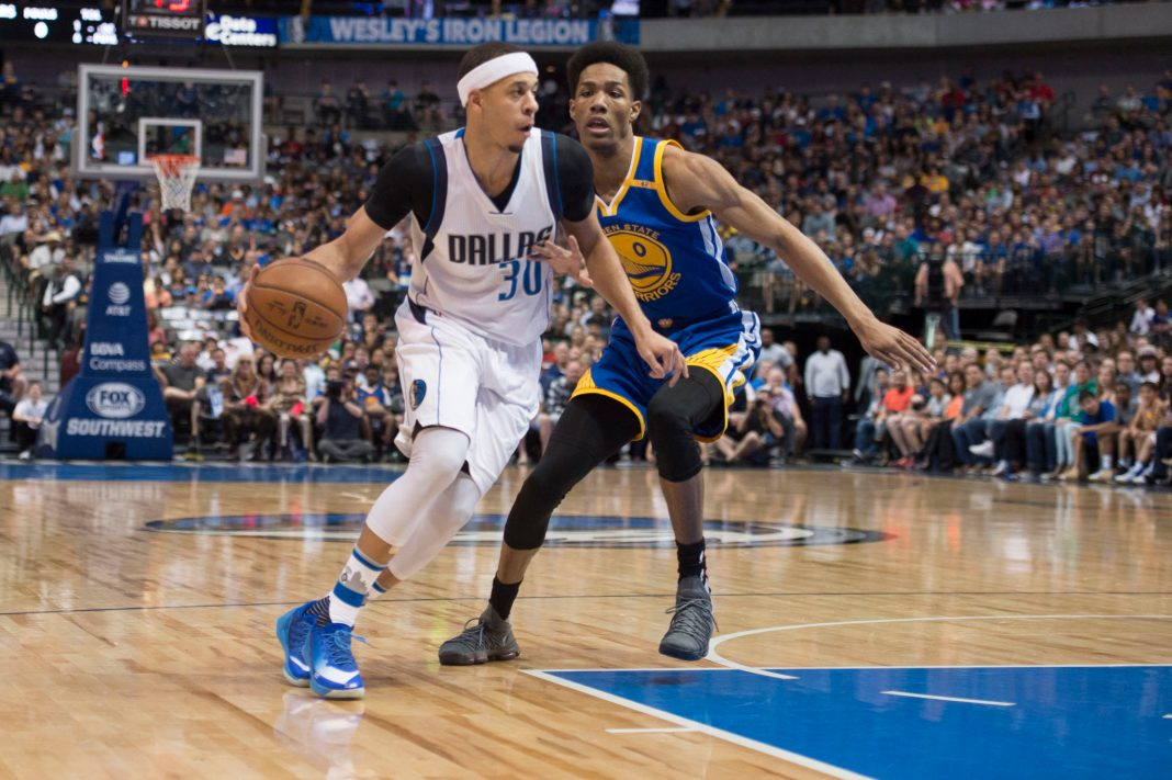 Mar 21, 2017; Dallas, TX, USA; Dallas Mavericks guard Seth Curry (30) dribbles the ball against Golden State Warriors guard Patrick McCaw (0) during the first quarter at the American Airlines Center. Mandatory Credit: Jerome Miron-USA TODAY Sports