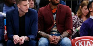 Apr 9, 2017; New York, NY, USA; New York Knicks forward Kristaps Porzingis (6) and forward Carmelo Anthony (7) look on the bench during game against Toronto Raptors at Madison Square Garden. Mandatory Credit: Noah K. Murray-USA TODAY Sports