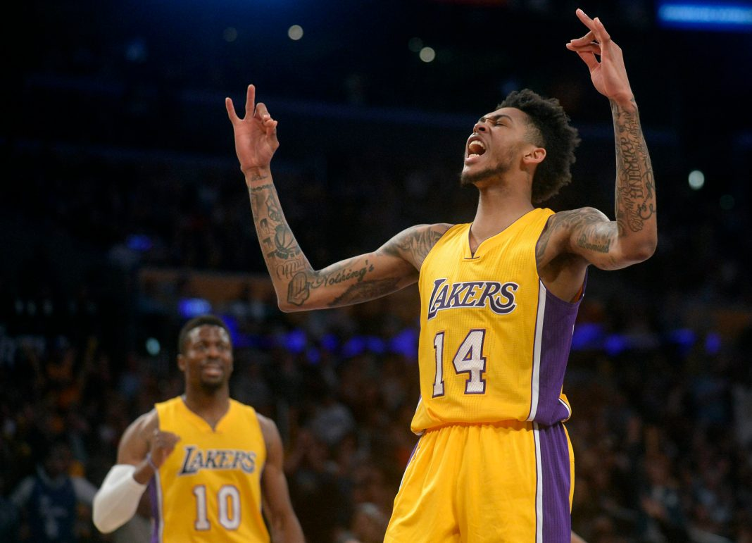 April 11, 2017; Los Angeles, CA, USA; Los Angeles Lakers forward Brandon Ingram (14) reacts after scoring a basket against the New Orleans Pelicans during the second half at Staples Center. Mandatory Credit: Gary A. Vasquez-USA TODAY Sports
